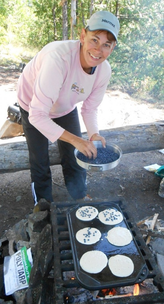 cooking blueberry pancakes over the campfire