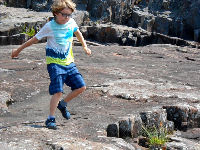 outdoor play on natural surfaces help our kids develop balance skills