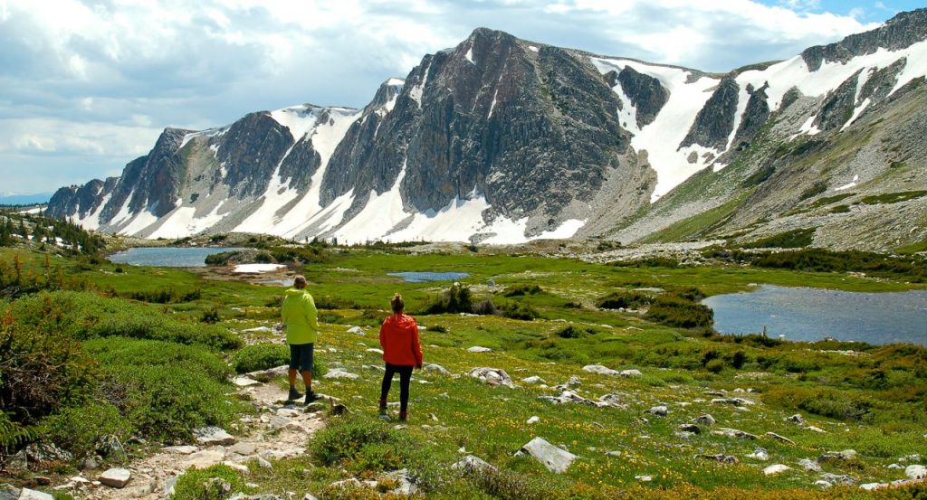 Active women hiking in the Snowy Range mountains
