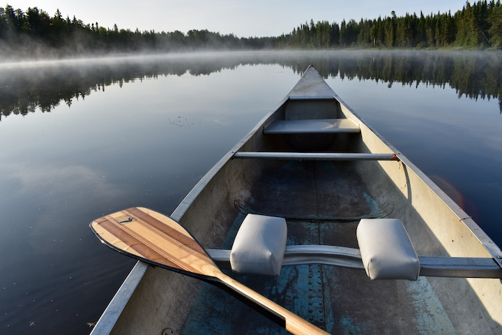 canoe on glassy lake